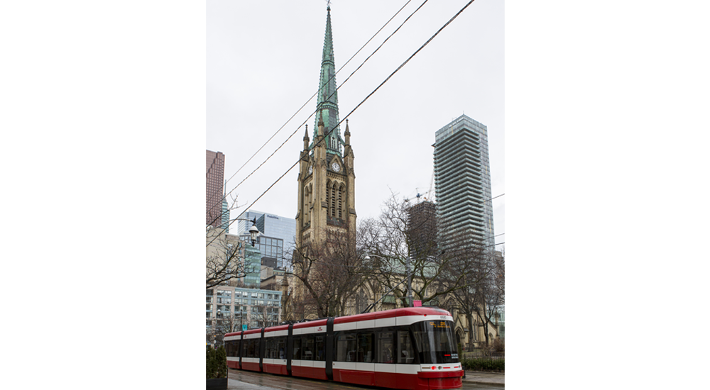 Cathedral Church of St James and a street car by St Lawrence Market