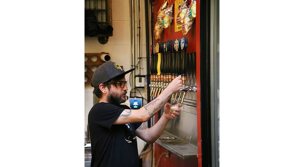 Pouring a draft beer during the Junction food tour
